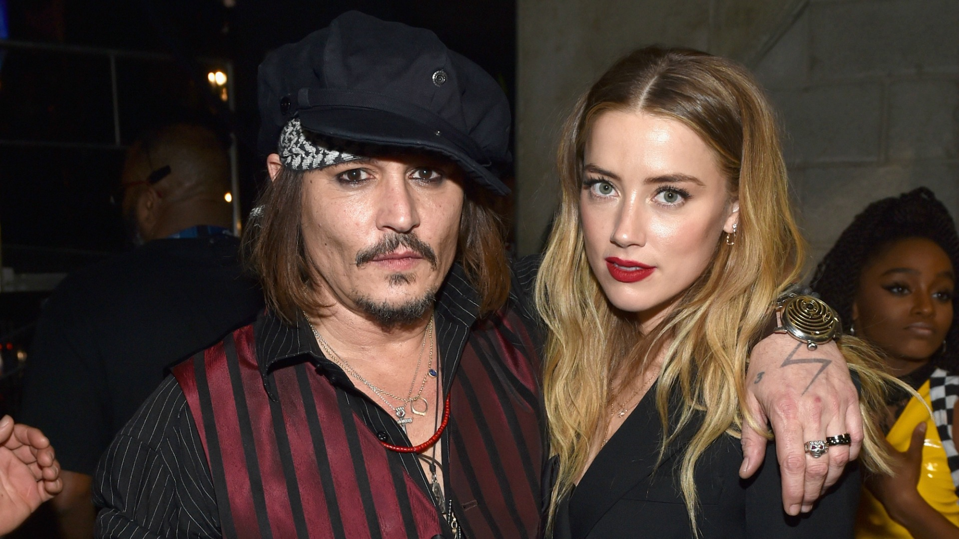 Amber Heard's bruises came from Saturday night fight – report
