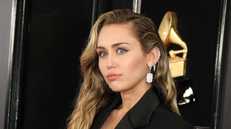 Miley Cyrus bid $100,000 at auction to hang out with her godmother Dolly Parton